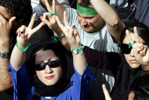 Tehran protest: Supporters of Mousavi flash the victory sign