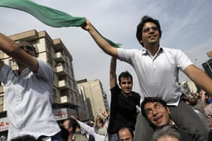 Tehran protest: Supporters of Mir Hossein Mousavi wave green flags