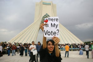 "Iran protests: An Iranian woman raises a sign reading ""Where is my vote"" in Tehran"
