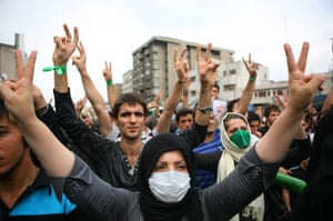 Iran protests: Supporters of Mousavi make victory signs