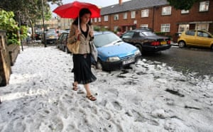 Extreme Weather: A woman walks home through the hail in Clapham