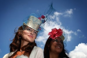 First day at Ascot: Ladies in hats pose for photographs