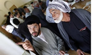 Iranian clerics check candidates' list before voting in Qom