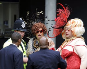 Ladies' Day at Ascot: Two men dressed as large women chat with the police before being evicted