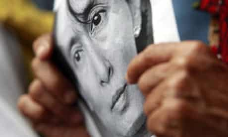 Portrait of Aung San Suu Kyi held by supporters in Manila on her 64th birthday