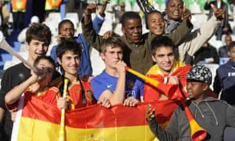 fans playing the vuvuzela