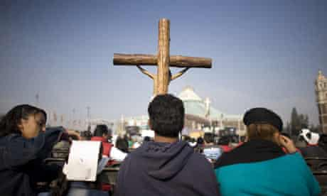 Worshippers attend mass in the plaza outside the Basilica of Guadalupe