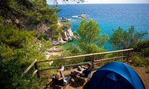 The beach campsite in Cala Llevado, Spain