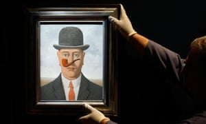 A painting is hung in the Magritte museum