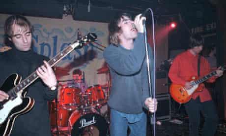 Paul 'Bonehead' Arthurs performing in Oasis