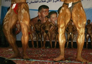 24 hours in pictures: Afghan men strike a pose during national bodybuilding competition Kabul