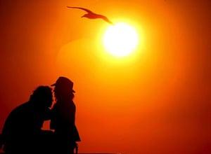 24 hours in pictures: Sunset At La Zurriola Beach In San Sebastian