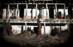 24 hours in pictures: Nepalese villagers pose in the village of Sawa Khola