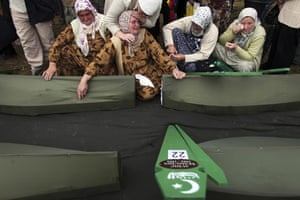 24 hours in pictures: Bosnian Muslim cries over coffins mass funeral Zvornik