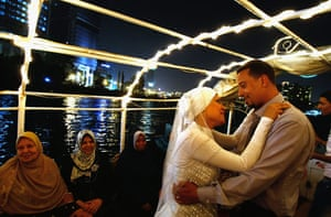 24 hours in pictures: Egyptian groom dances with his bride in Cairo