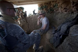 Sean Smith Afghanistan: Soldiers from Blackfoot Company smoek as they man an observation post