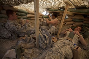 Sean Smith Afghanistan: Soldiers from Blackfoot Company eat lunch at an observation post