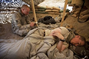 Sean Smith Afghanistan: Soldiers from Blackfoot Company read and rest at an observation post