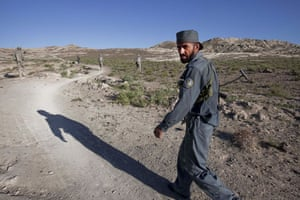 Sean Smith Afghanistan: A member of the Afghan National Police leaves Ashak