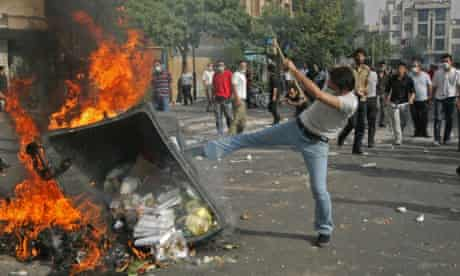 Supporters of opposition leader Mir Hossien Mousavi set fire to a barricade in Tehran