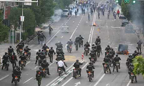 Police and protesters in Tehran on 20 June 2009