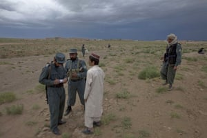 Sean Smith in Afghanistan: Afghan police question bypassers after a vehice was hit by an IED