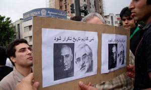 In Iran, supporters of Mir Hossein Mousavi hold a sign with his image and that of Muhammad Mossadeq. Photograph: Anonymous (courtesy of Stephen Kinzer)