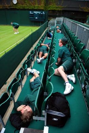 Style at Wimbledon: Ground staff take a break before the 2009 Wimbledon Championships