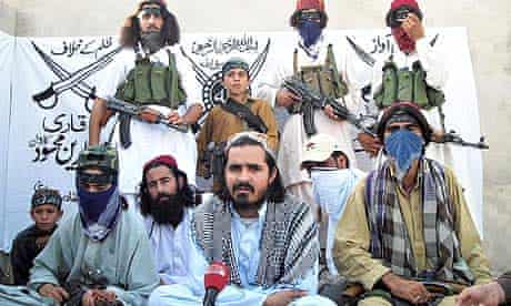 Qari Zainuddin (c), surrounded by his armed guard in the town of Dera Ismail Khan.