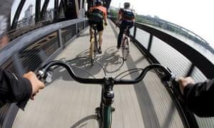 Bike blog: Bike rider view of 2 cyclists commuting across bridge