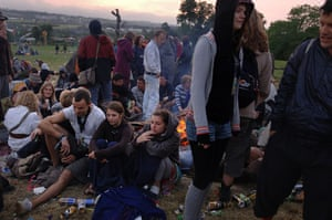 First day at Glastonbury: Revellers by a bonfire, sunrise at the stone circle at the Glastonbury