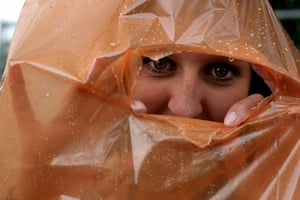 First day at Glastonbury: Sheltering from the rain at the Glastonbury Festival