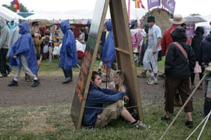 First day at Glastonbury: Sheltering from the rain at the Glastonbury