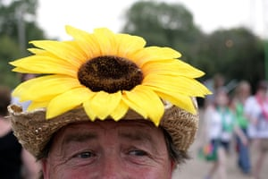 First day at Glastonbury: sunflower dress sunflower hat at Glastonbury