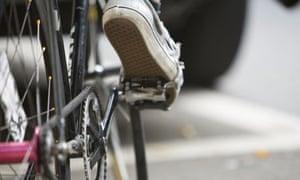 Bike Blog: Man riding bicycle hold in traffic