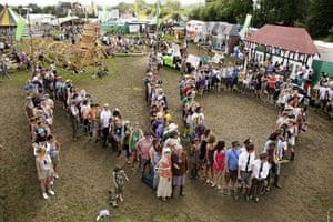 Glastonbury crowds: Glastonbury crowds greenpeace protest human no