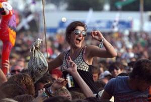 Glastonbury crowds: Glastonbury crowds woman cheers lady gaga