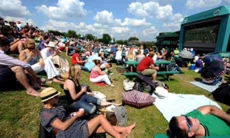 Tennis fans enjoy the sun on Murray Mount