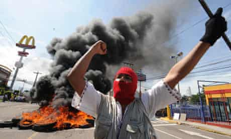 A supporter of the exiled president in Honduras
