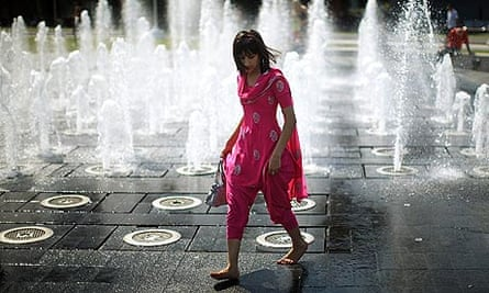 Hot weather: A student cools off in the fountains of Piccadilly Gardens in Manchester