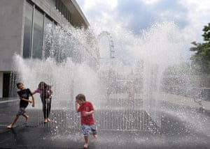 UK weather update:  Children enjoy the weather in the Royal Festival Hall's fountain