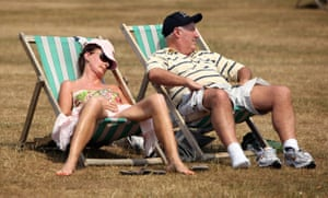 UK weather update: A couple relax on deckchairs in the sun in Hyde Park