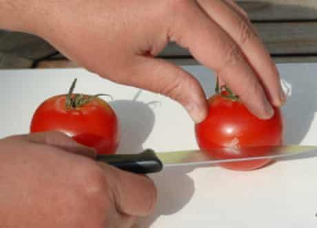 Slice the tomatoes in half
