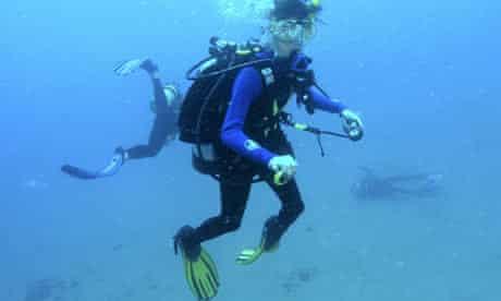 Novice diver Christina Watson lying motionless