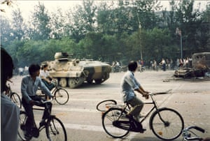 Tiananmen protests 1989: An armoured vehicle passes cyclists, Fuxing Road at Gongzhufen
