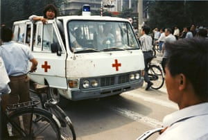 Tiananmen protests 1989: An ambulance carrying wounded people drives west from Tiananmen Square