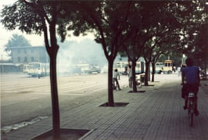 Tiananmen protests 1989: A tank pushes through a roadblock of buses set up by civilian protesters.