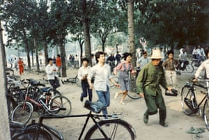 Tiananmen protests 1989: Civilians flee from gunfire at intersection of Fuxing and Wanshou Roads