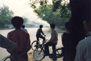 Tiananmen protests 1989: PLA solders block the road to collect the bodies from the destroyed trucks