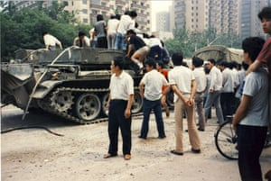 Tiananmen protests 1989: Civilians climb atop an armoured vehicle Fuxing Road, Beijing